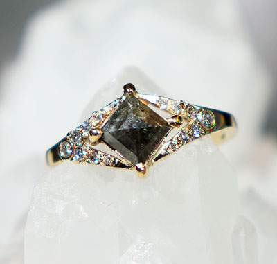 Facets of Earth engagement ring