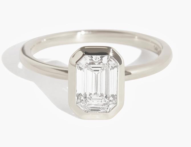 Vrai signature bezel emerald cut diamond engagement ring