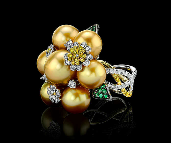 Ring with golden South Sea golden pearls, fancy yellow and white brilliant-cut diamonds, and green garnets in 18k white gold, $5,000;
