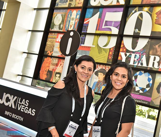 Mariana and Lorena Bobadilla with JCK 150 sign