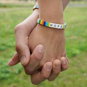 Rainbow for Hope bracelet hands
