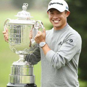 Collin Morikawa with PGA trophy