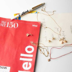 The Met x Catbird map and jewelry