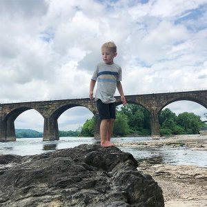 Mark son Nolen on a rock along Susquehanna River