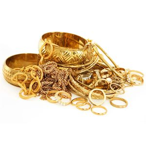 Pile of gold bracelets chains and rings