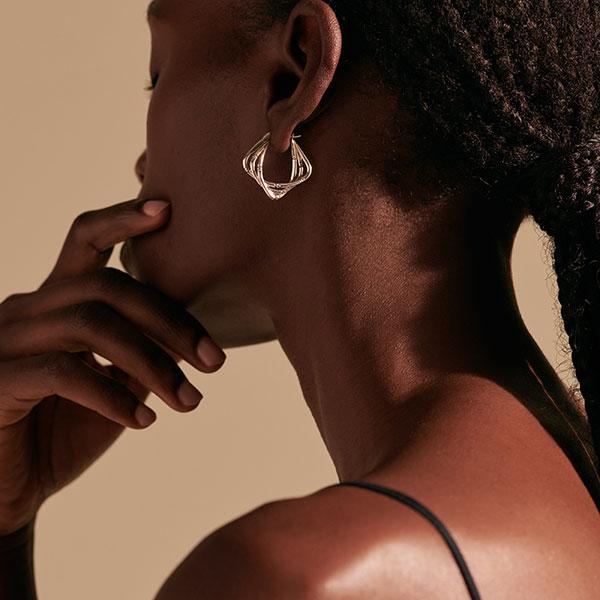 John Hardy Bamboo earrings on model