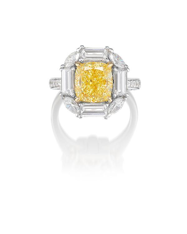 A 5.01 carat fancy yellow diamond ring