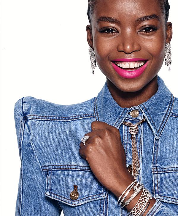 Model in denim with diamond bolo necklace