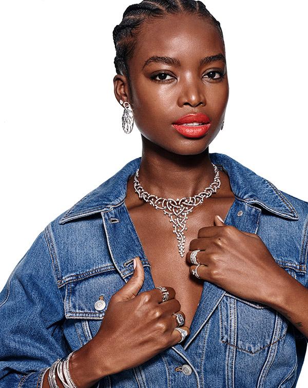 Model in denim with major diamond necklace