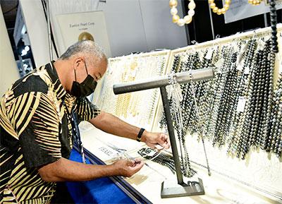 Man looking at pearls