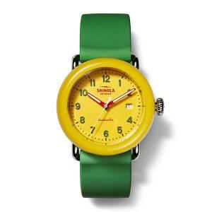 Shinola's new Crayola watch celebrates the brand's iconic green-and-yellow box colors.