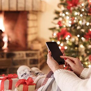 Woman on phone at fireplace