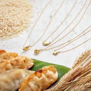 Delicacies Jewelry's gyoza, pierogi, soup dumpling, and ravioli dumpling pendants.