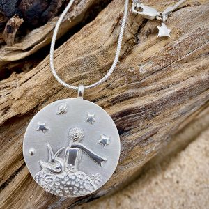 Le Petit Prince Collection Pendant comes on a 30-inch snake chain that can be worn long or doubled to wear at choker length. A mini star is attached to the clasp, giving the back of the piece a special touch.