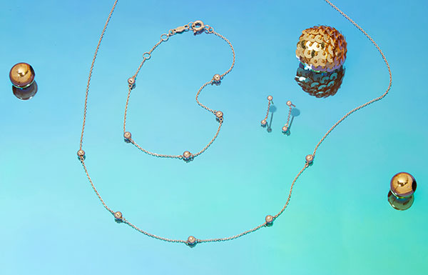 Stone and strand golden beads