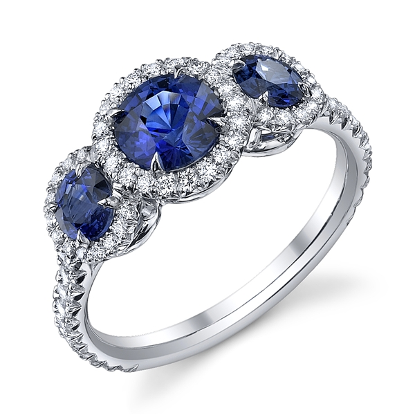 Omi Prive three-stone sapphire halo engagement ring