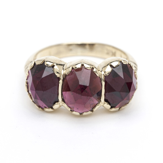 Three-stone ring in 14k gold with garnets by Arik Kastan