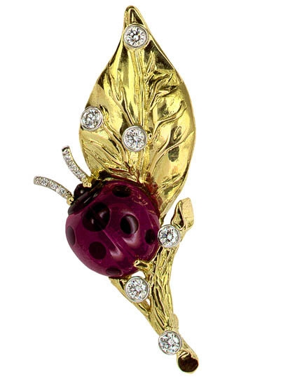 Gumuchian ladybug on a leaf brooch