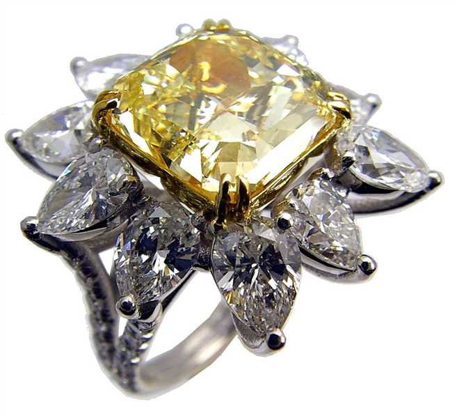 International House of Platinum fancy yellow diamond flower ring