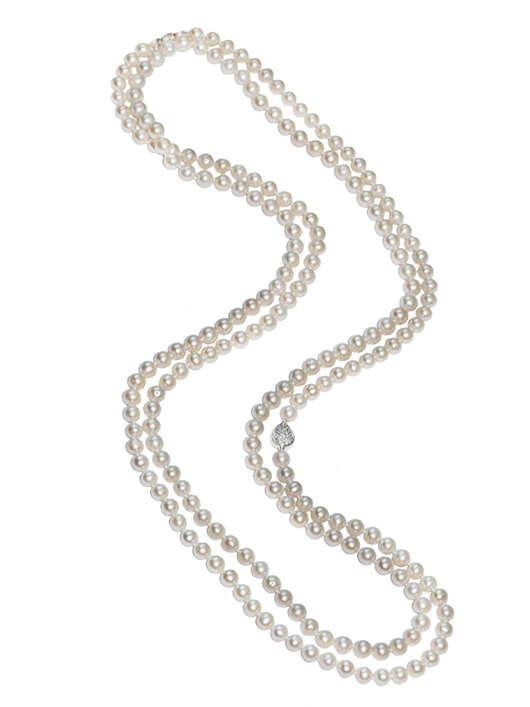 Anzie long pearl necklace with clear topaz in a silver clasp for $850
