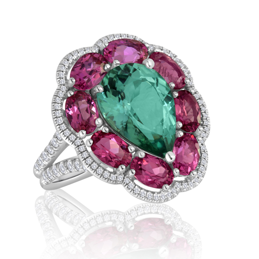 Ring in 18k gold with 4.7 cts. t.w. neon blue-green tourmaline, 4.42 cts. t.w. red spinels, and 0.55 ct. t.w. diamonds for $19,000 by Campbellian Collection