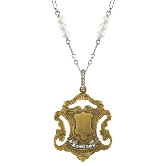 Vintage-inspired charm in 18k gold on silver chain by Anabel Higgins