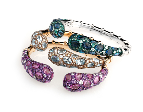 Bracelets by Verdi in 18k gold with gemstones (see center piece with aquamarine and brown and colorless diamonds)