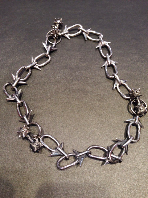 Oxidized silver bracelets as a necklace with spiked barbell toggles by Sofie Cawood