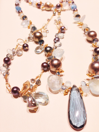 Necklaces in karat gold with pearls and mixed gemstones by Laura Gibson