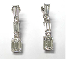 Diamond earrings from Chopard worn by Debra Messing to the 2014 Emmys