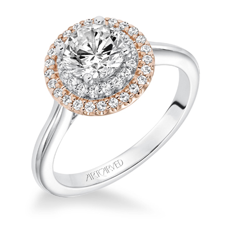 A halo diamond ring in white and rose gold by the Artcarved division of Frederick Goldman