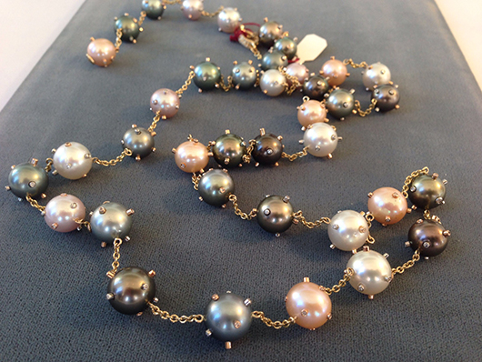 Pearl strand with bezel-set gems by Hector Hassey