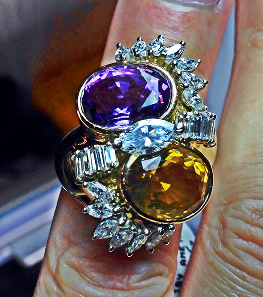 Vintage ring in yellow gold with amethyst, citrine, and diamonds from Betteridge at the show