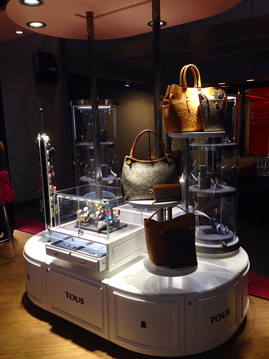 A Tous display of bags, scarves, fragrances, watches, and jewelry at VicenzaOro