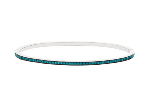 Dazzling Blue-colored diamond bangle by World Trade Jewelers