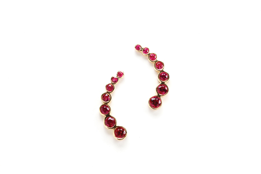 Ruby ear climbers in 18k yellow gold with 1.65 cts. t.w. rubies; $1,900; Rina Limor, NYC; 212-922-9292; rinalimor.com