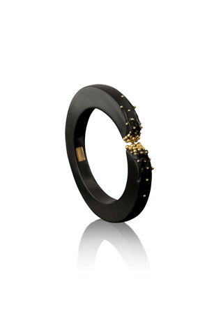 Hand-carved ebony bangle with 18k gold granulation, $2,400; Jacqueline Cullen