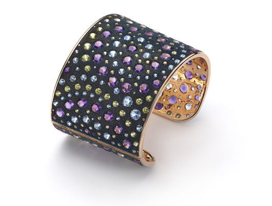 Cuff bangle in 18k gold from the Nuit colleciton with peridots, amethysts, blue topaz, and 0.28 ct. t.w. diamonds, $26,000; Mattioli