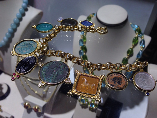 Gold and Venetian glass charm bracelet from Mazza