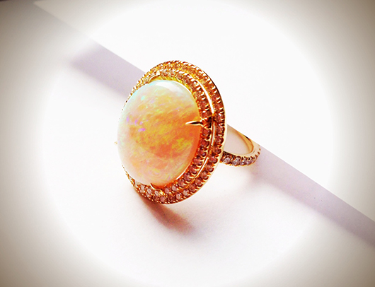 Ring in gold with opal and diamonds by Nina Runsdorf