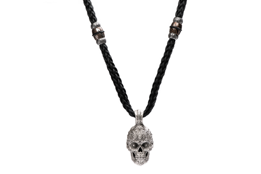 Skull necklace in sterling silver with mokume gane accents on soft black bulletproof Kevlar cord, $1,500; William Henry