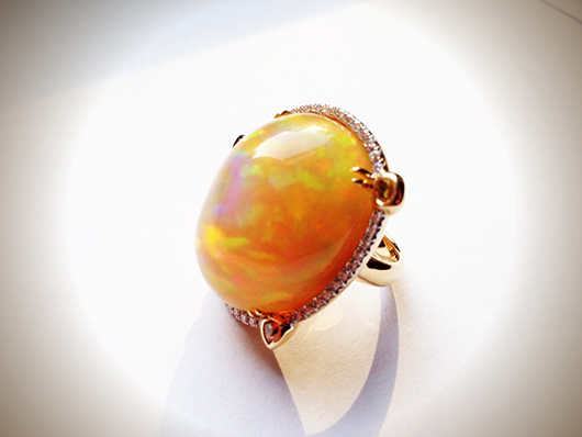 Ring in gold with opal and diamonds by Pamela Huizenga