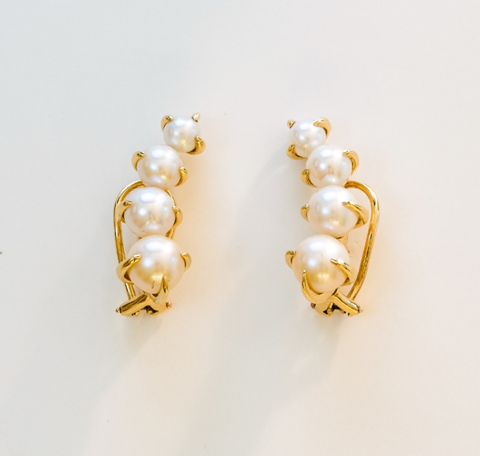 Ear climbers in yellow gold and pearls by Ana Khouri worn by Michelle Dockery to the 2014 Emmys