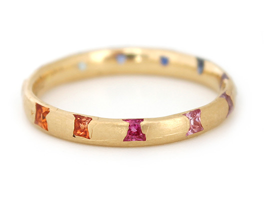 Band in gold with rainbow-colored gems from Polly Wales