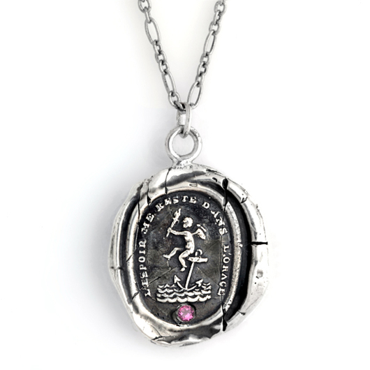 Pyrrha's silver Cherub of Hope necklace with pink tourmaline accent benefits breast cancer research