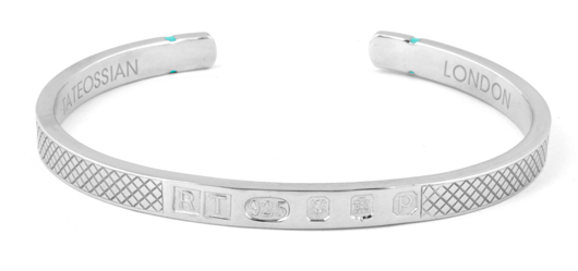 Cuff bangle in sterling silver with Paraiba-color topaz accents, $450; Tateossian
