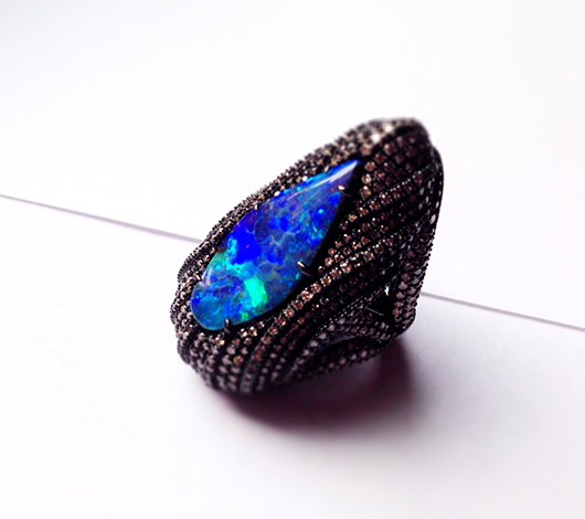 Ring in gold with black rhodium, opal, and diamonds by Sutra