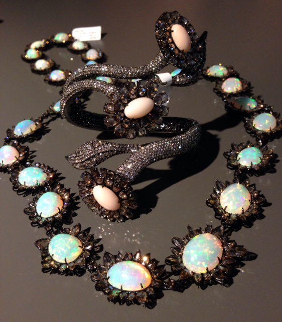 Sutra brown diamond necklace with Ehtiopian opal and a cuff with brown diamonds and Angel Skin coral
