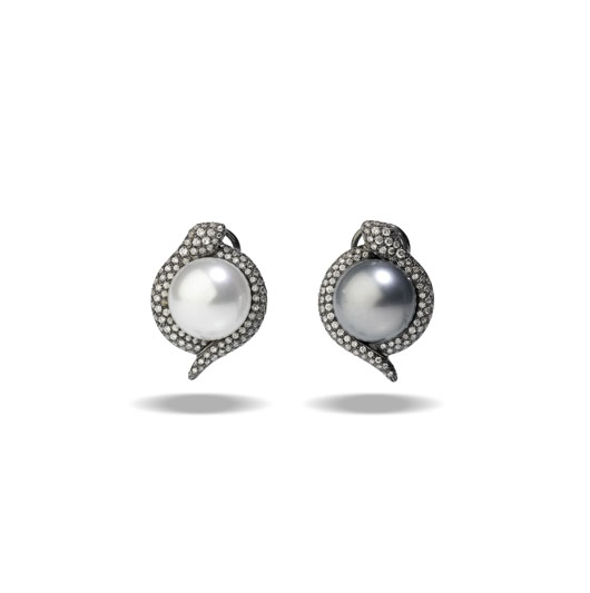 Utopia mismatched earrings with one black and one white South Sea pearl