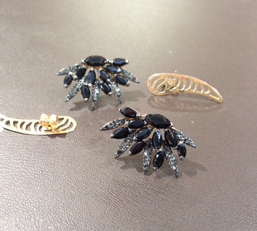 Flared stud earrings with black spinel and diamonds by Vancox